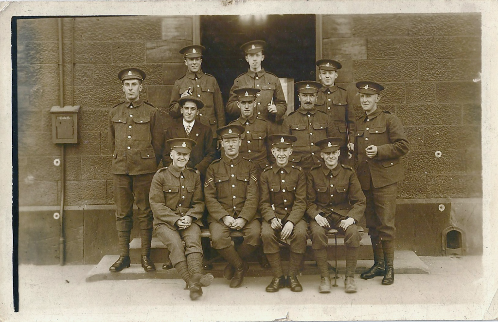 Group of 12 servicemen, presumably at Hillsborough Barracks, Sheffield: ALL in centre of middle row.