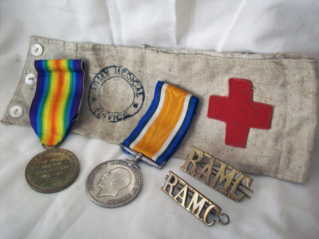 ALL's 1914 - 1918 medal, his 'Victory' medal, and his RAMC armband and brass shoulder-plate